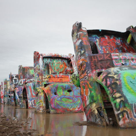This photo was taken at Cadillac Ranch in Texas. I like how it shows such an odd piece of art in the middle of nowhere.