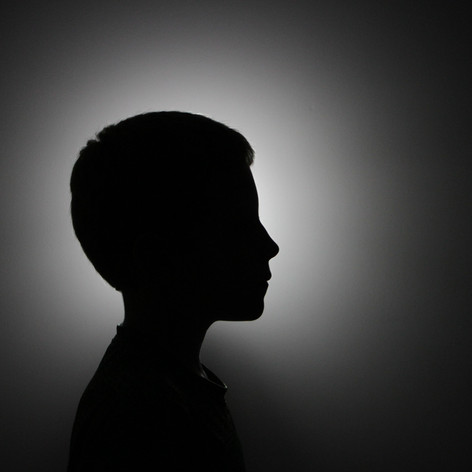 I shot this portrait of my brother against a plain colored wall with a light behind him to create a sillhouette. I like how interesting but simple this photo is.