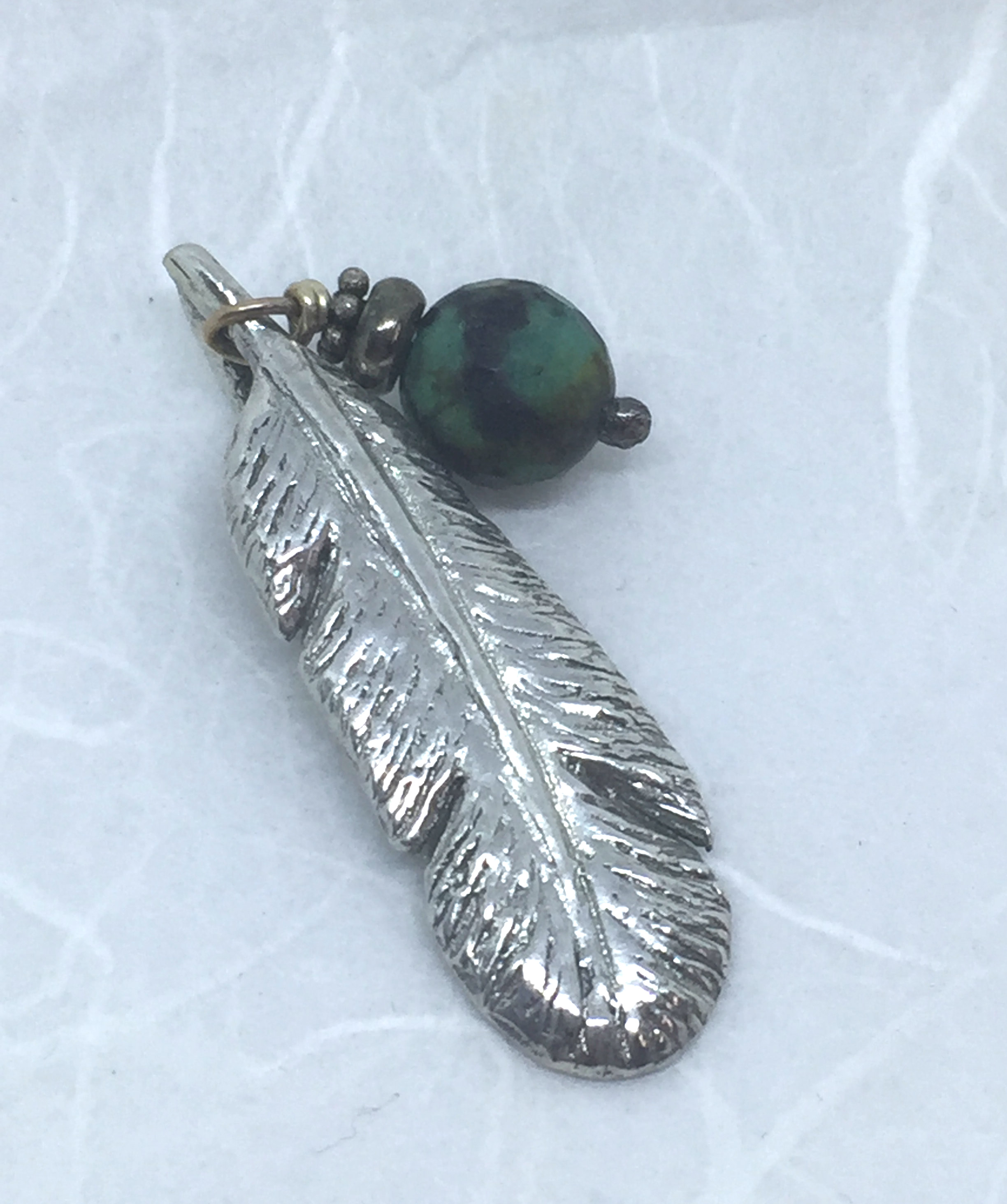 feather and tuquoise pendant