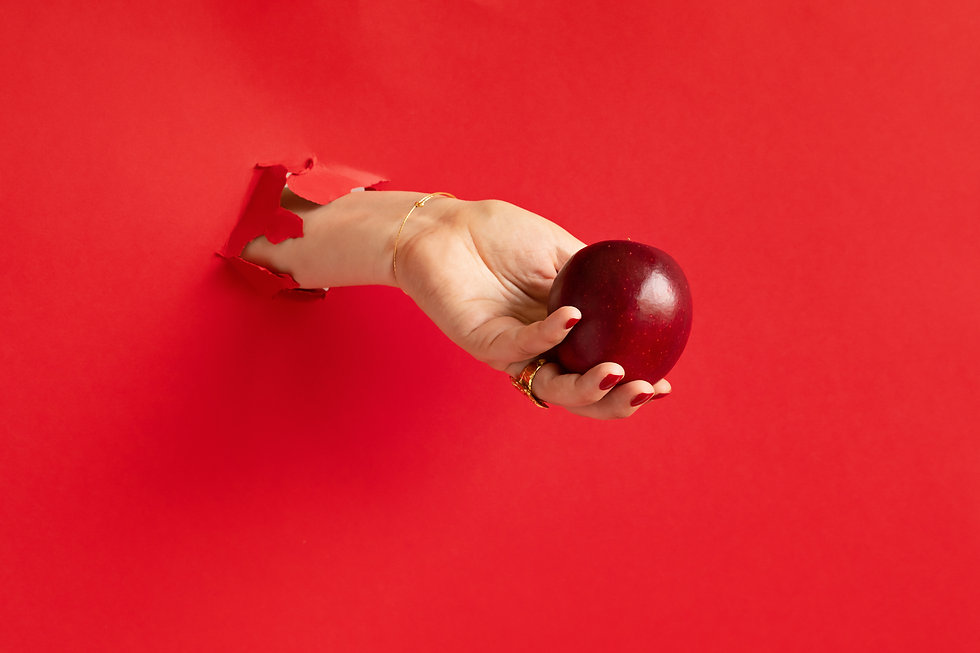 woman-hand-holding-red-apple-through-hol