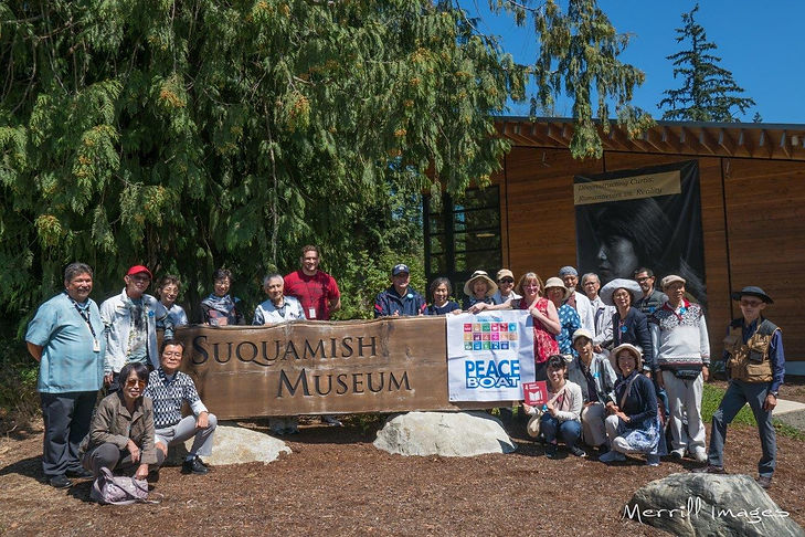 Gathering around Suquamish Museum sign
