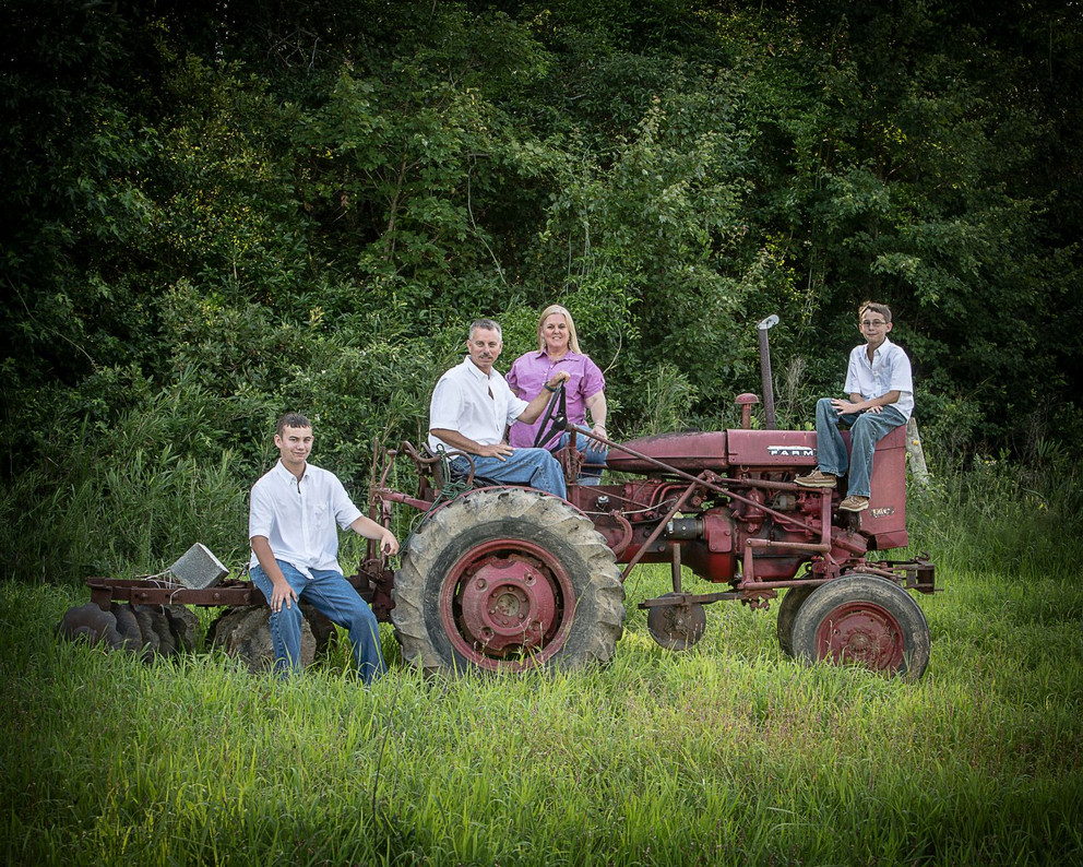 Family on tractor
