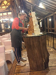 High Rocks venue Setting up a rustic wedding cake in Kent