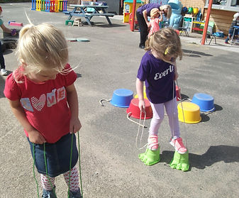 Children playing ouitside in pre-school playground