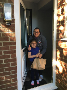 A lady and her daughter receiving their delivery in Kidlington
