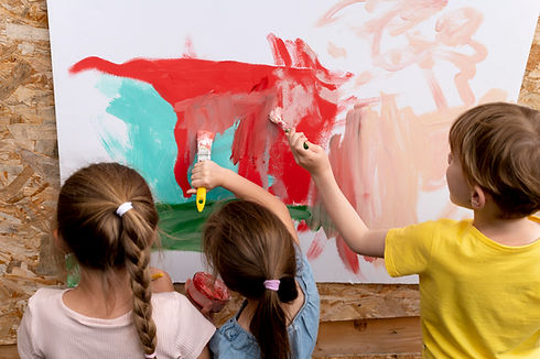 close-up-kids-painting-together.jpg