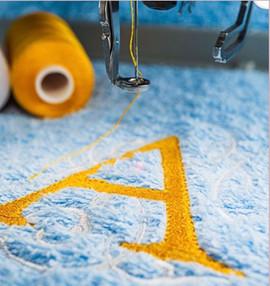 embroidery onto a towel