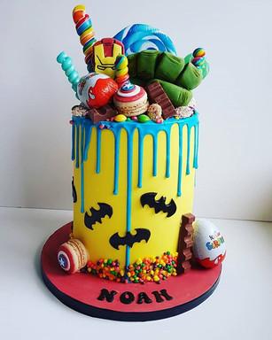 Here is Noahs Marvel themed drip cake.jp