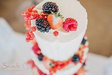 Rustic Buttercream wedding cake with fresh summer berries