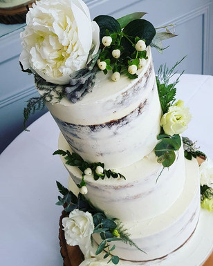 Simply beautiful semi naked wedding cake