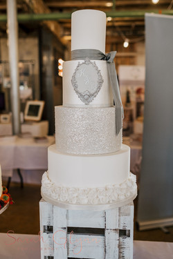 4 tier grey & white wedding cake with monogram initials, lustre, sparkle & ruffles