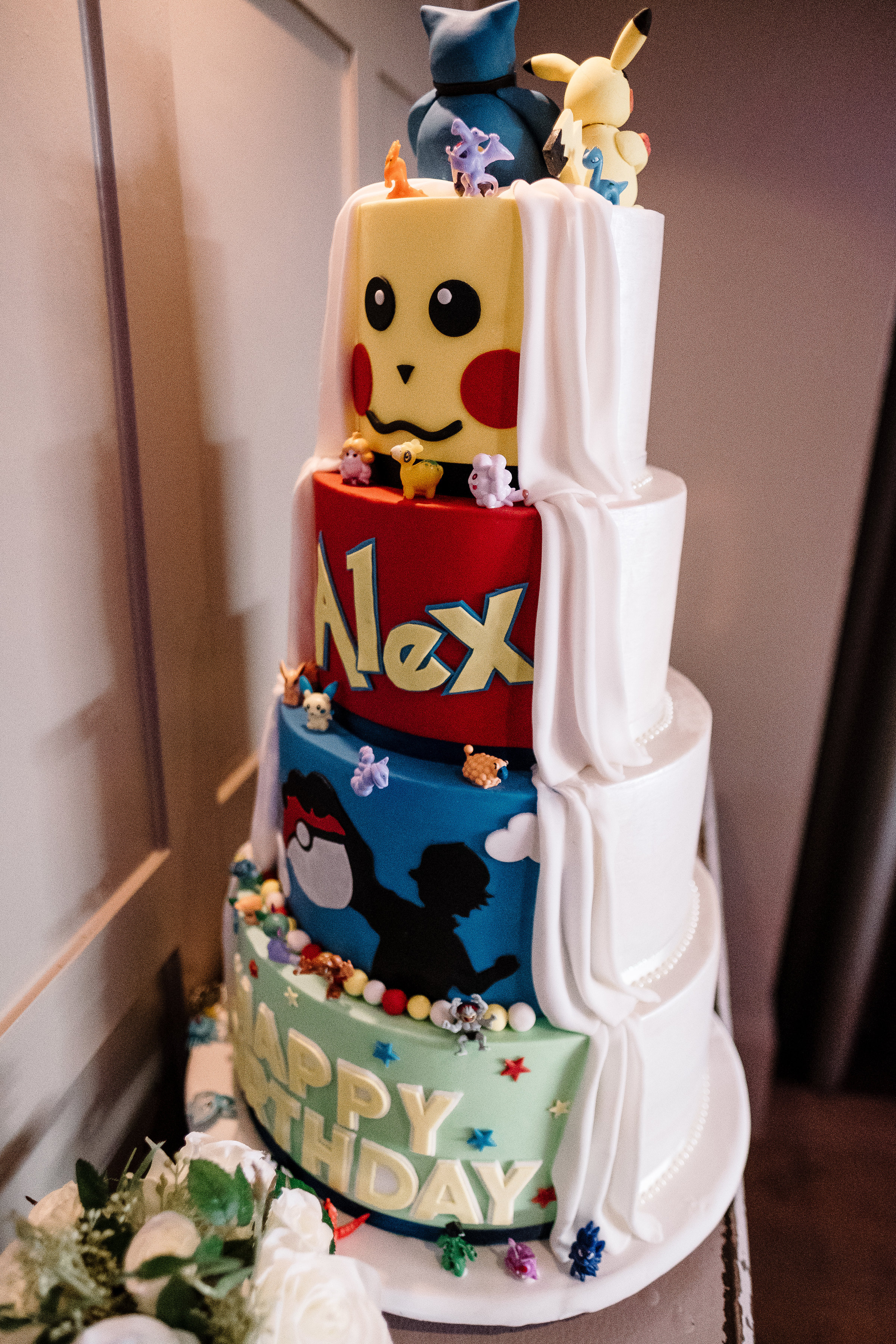 4 tier reveal wedding cake - Half traditional bridal and half pokemon themed