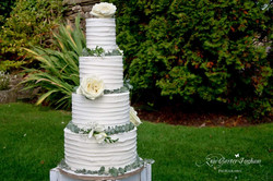 Rustic Buttercream 4 tier wedding cake with fresh roses and eucalyptus