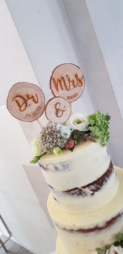personalised cake topper on a semi naked wedding cake