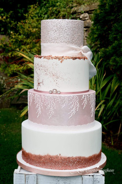 Rose gold, blush pink and white 4 tier wedding cake