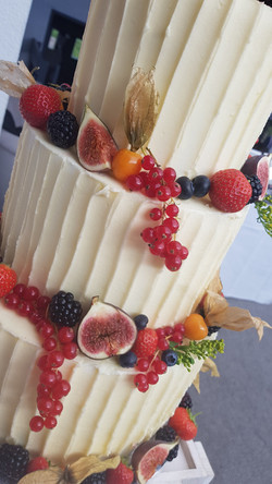Rustic Buttercream Wedding cake with fresh fruit