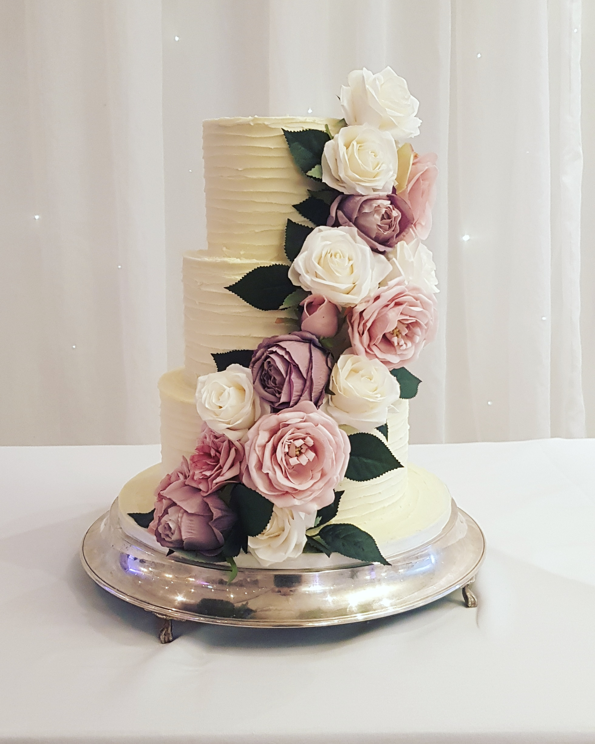 3 tier rustic wedding cake with silk flowers