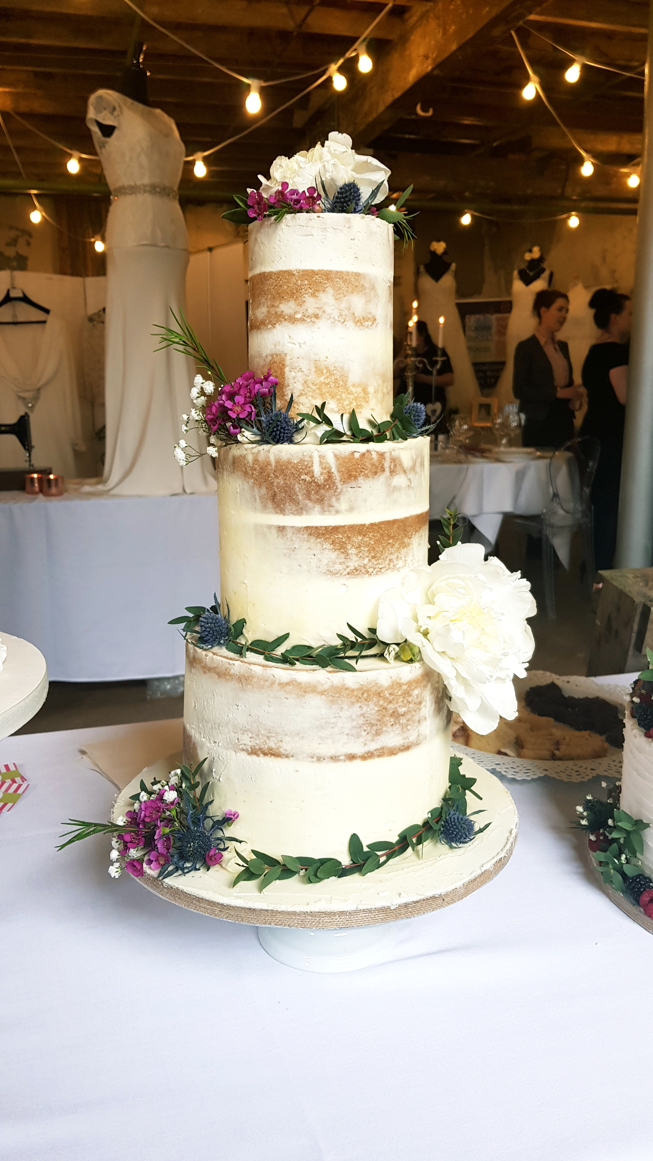 3 tier semi naked wedding cake with fresh peonies