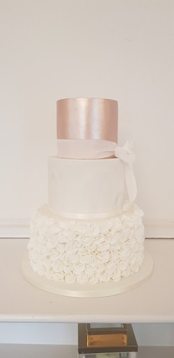 Rose gold, marble and ruffles wedding cake