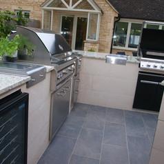 Outdoor Kitchen - Granite worktop, inner tiled walls