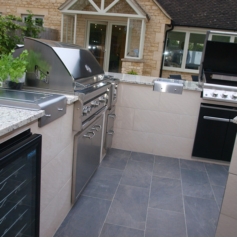Outdoor Kitchen - Granite worktop, inner tiled walls