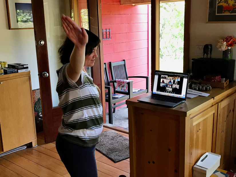 Name: Edward Wong	  Ethnicity: Chinese American  Age: 69  Date Image was Captured: 4/23/20  Time Image was Captured: 3:30:00 PM  Location Image was Captured: Oakland, CA  How would you describe your image, to someone who may be visually impaired?  A young lady smiles as she dances in front of a laptop computer connecting her to a dance class via Zoom.  What does this image mean to you?  We find joy where we can during lockdown. My daughter Sara was sheltering in place with me away from her friends at her residential home for disabled adults. Here, she enjoys a dance class with housemates via zoom.  Based on your COVID-19 experience, what would you like to see changed in your world, that may or may not be related to your image?  I'd like to see a more compassionate world where we learn to care for one another.
