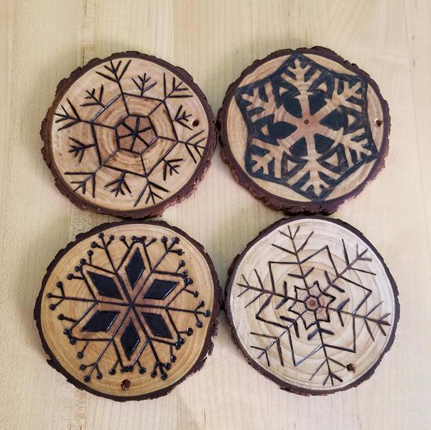 Wood burned coasters by Eli Cooper.jpg