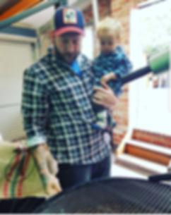 Josh holding Mars at roaster.jpg