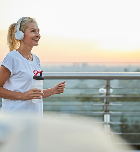 Fit-lady-with-a-plastic-bottle-jogging-o