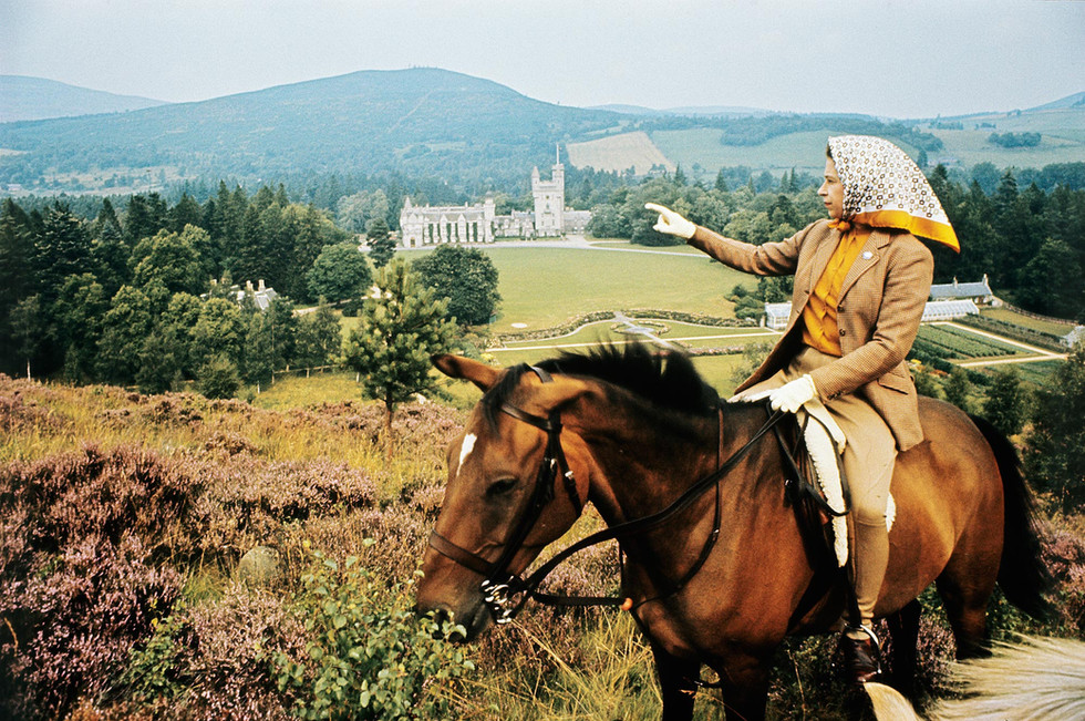 How does the Queen spend her holidays in Balmoral?