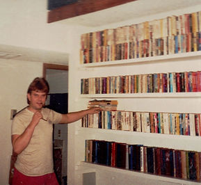 Standing by my bookcase.jpg