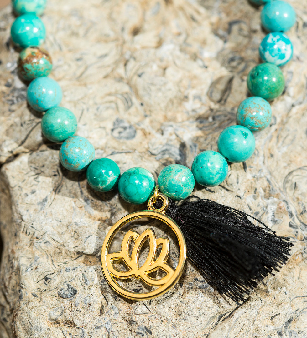 Bracelet with lotus charm