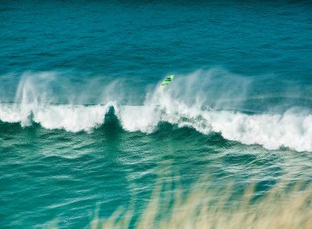 Surfer Loses Board