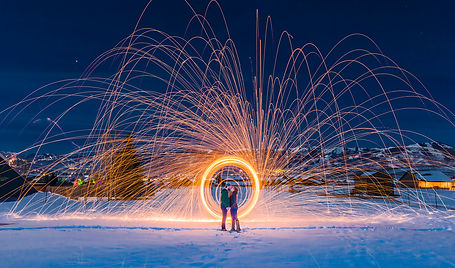 couple kissing at night in the snow with sparks flying