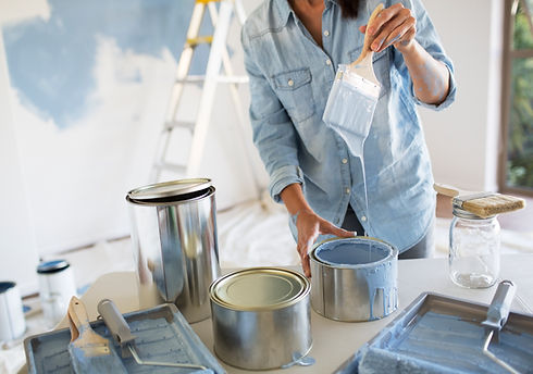 Painter Painting a New Wall with light blue paint