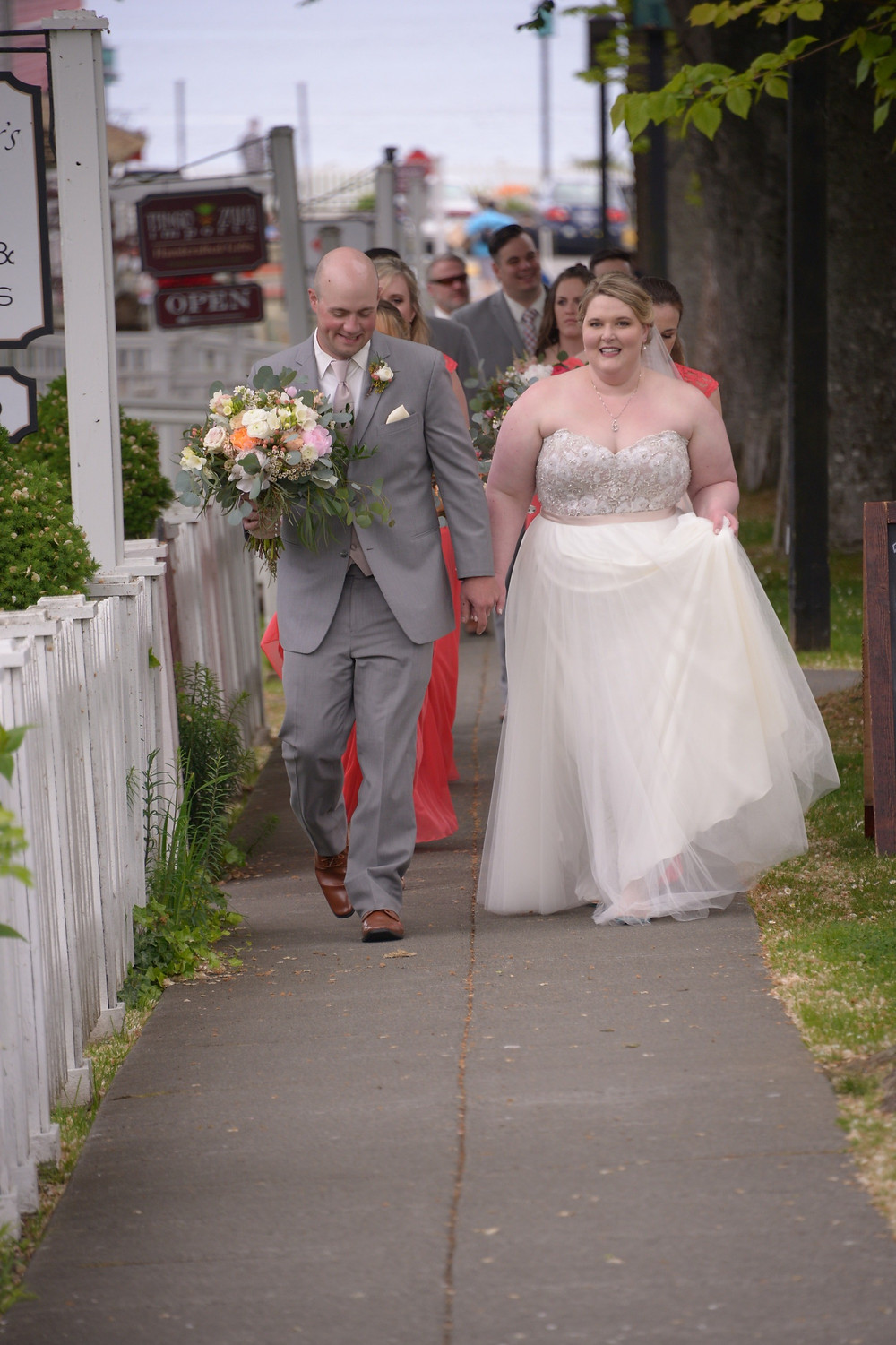 bridal party walking in quaint town of Port Gamble