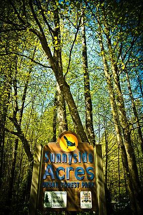 Parking lot entrance sign to Sunnyside Acres Urban Forest