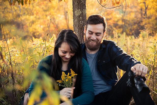 Pittsburgh Wedding Videographers Matt and Penny sitting under a tree.