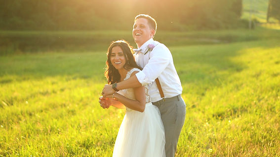 Bride and Groom laughing during sunset