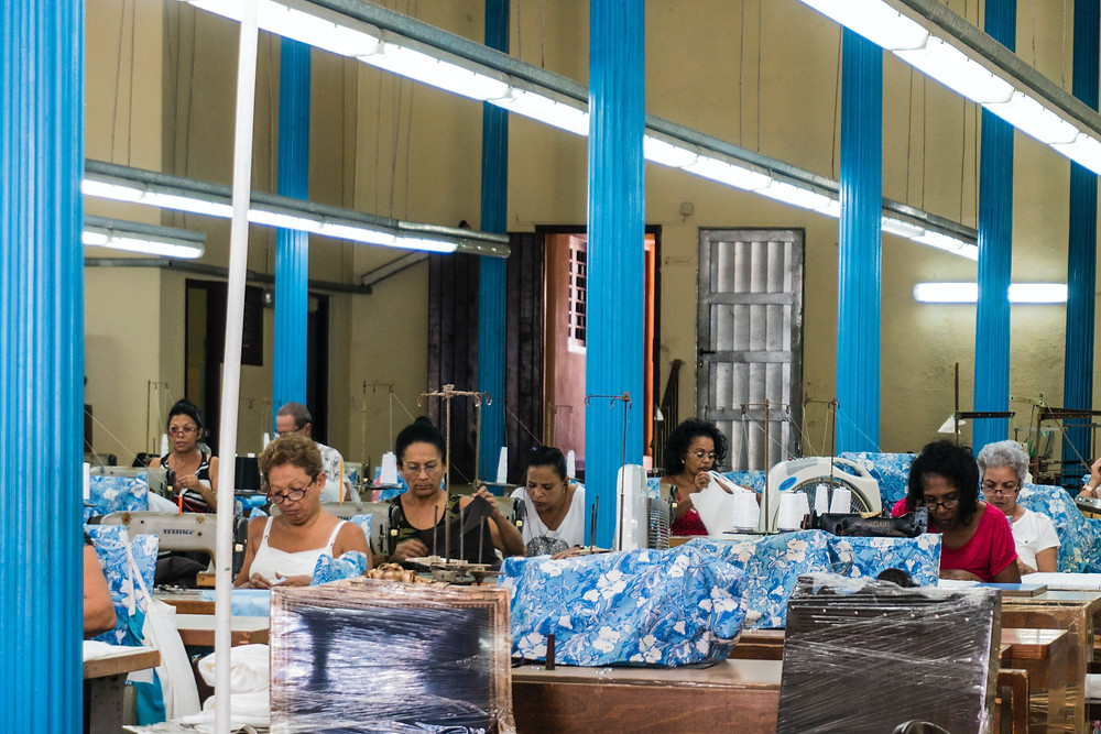 factory workers making chairs in Havanna