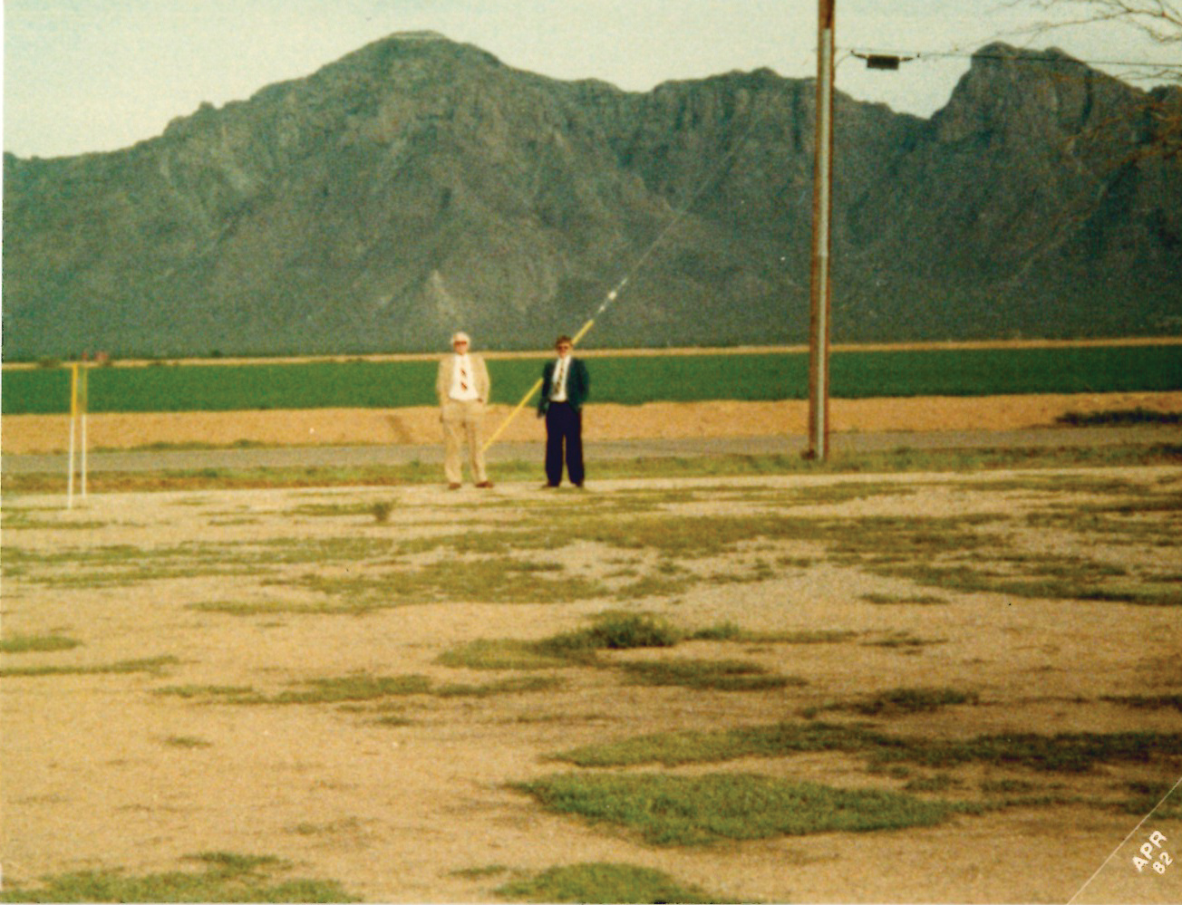 1982: Morry and Larry Carlson stand on the Arizona property and seek God's guidance for the future of the newly acquired ministry location