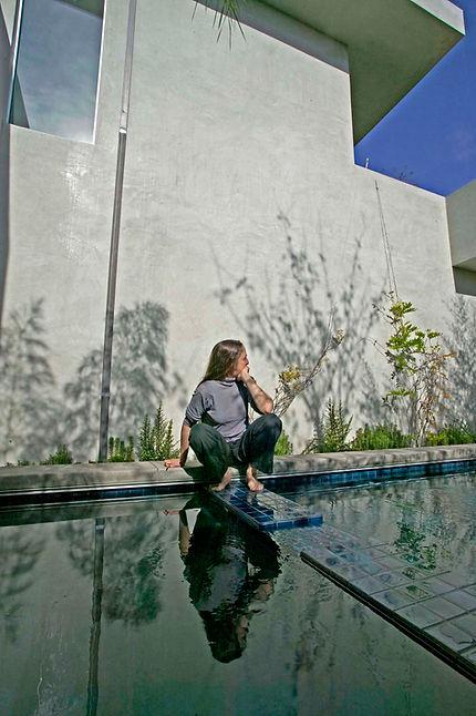 Woman gazing at reflecting pool