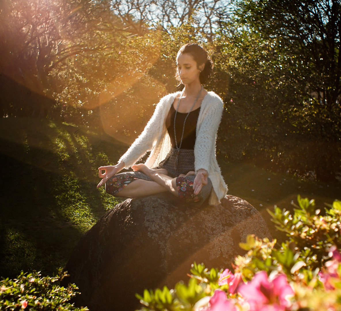 woman-meditating-on-rock-2597205.jpg