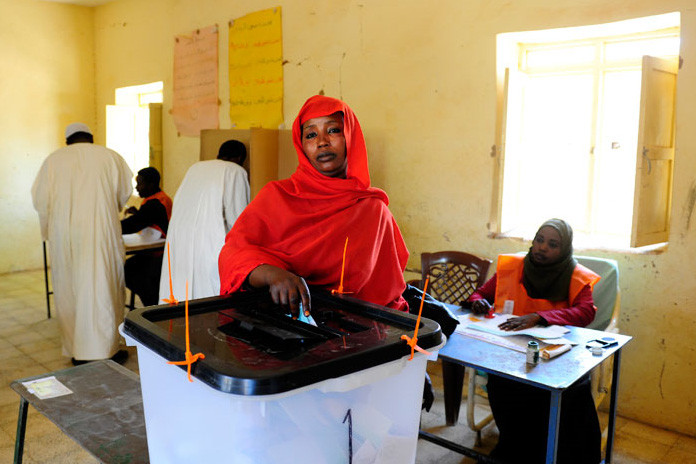 Sudan elections 2010 woman voting EU.jpg