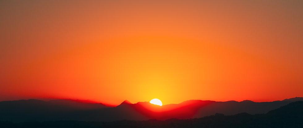 sunshine-over-dark-silhouette-of-mountai