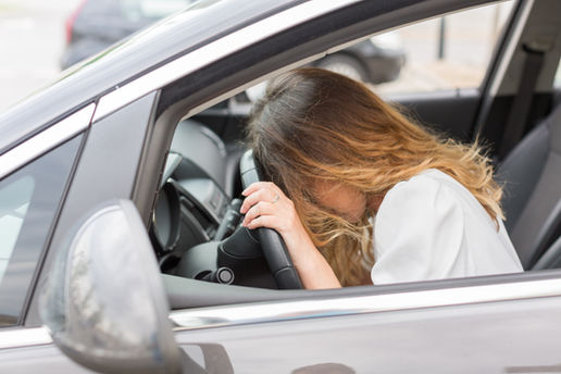 Frustrated young woman stuck in a traffi