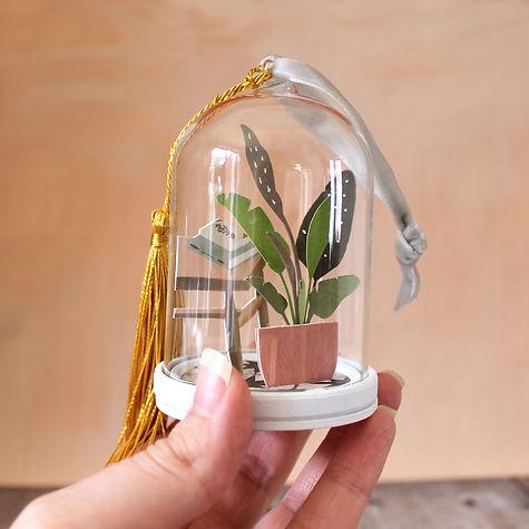 Papercut house plant cloche