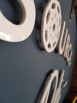 Perspex logo on wall
