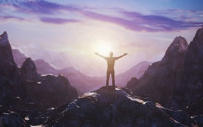 man-with-arms-up-mountain_edited.jpg