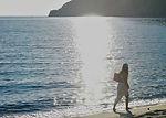 girl walking on shore_edited.jpg